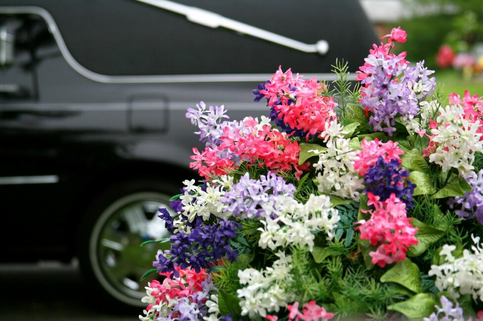 funeral-concepts-hearse-and-flowers-1573755331255x837preview.jpeg