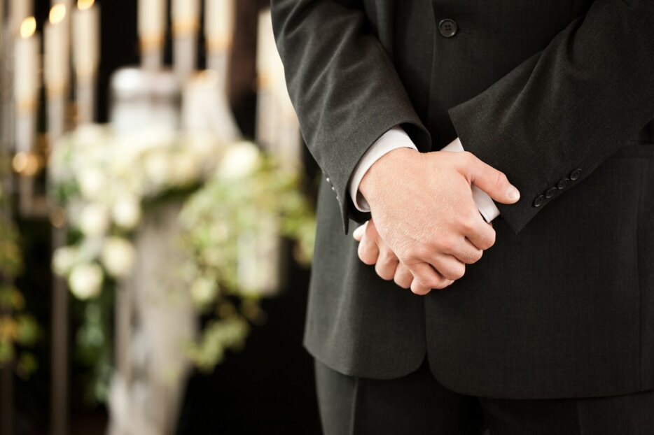 man-or-mortician-at-funeral-mourning-4672765915398x3598preview.jpeg