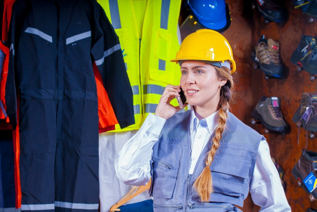 woman-in-gray-vest-with-yellow-hard-hat-inside-room-209719